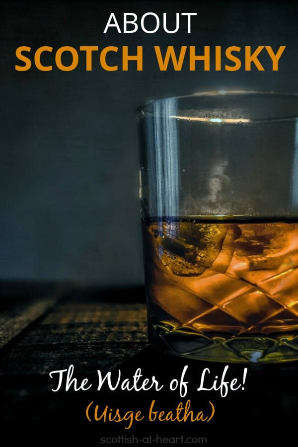 Glass of Scotch Whisky on old wooden table