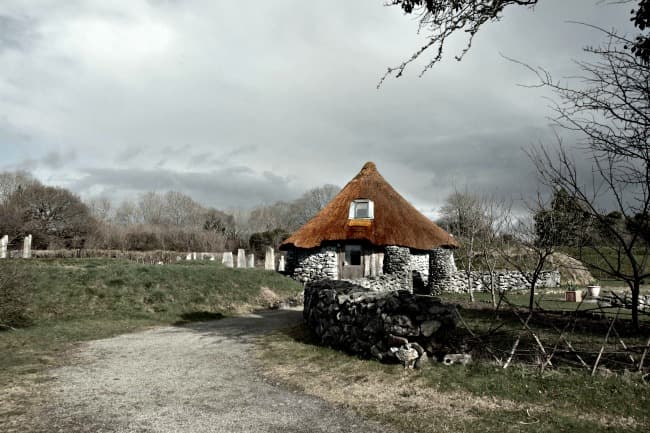 Ancient thatched cottage in countryside