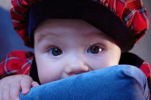 Baby girl in Scottish tartan outfit