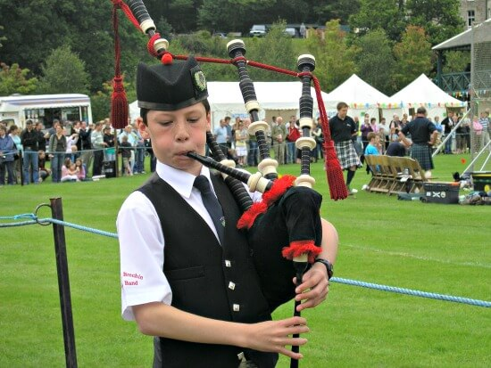 Piper in traditional Scottish Highland Games