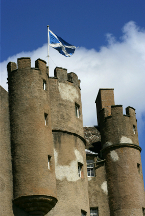Scottish Saltire flag flying over castle