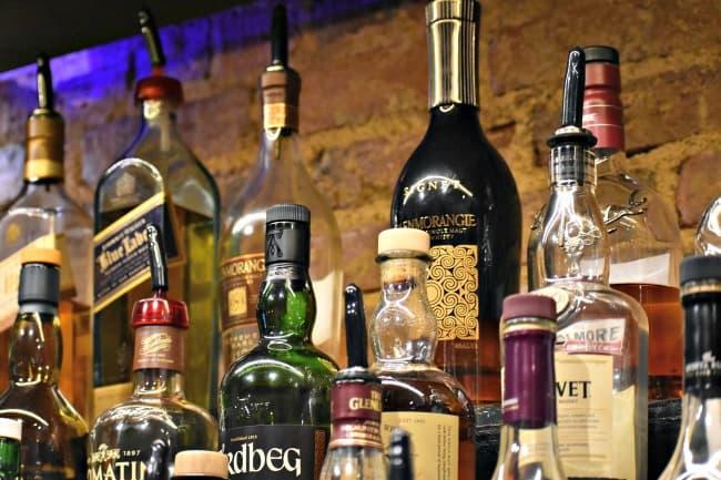 Assorted Scotch whiskies on pub shelf
