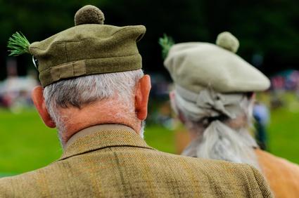 Two men watching Scottish Highland Games