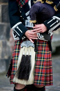 Scottish bagpipe player wearing a kilt
