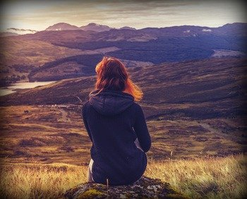 Scottish girl enjoying the Highland scenery
