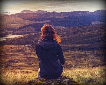 Scottish girl enjoying the Highland scenery