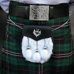 Scottish tartan kilt worn with sporran and thistle belt-buckle
