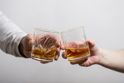 Slàinte with whisky glasses